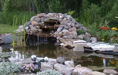 Customer's Pond and Waterfall Using Our Greenhouse Poly